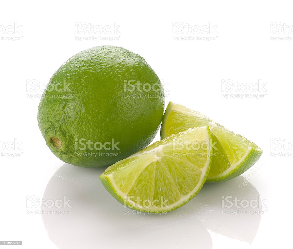 Two limes, one whole, one sliced royalty-free stock photo