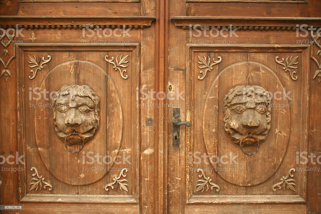Two lions on wooden door royalty-free stock photo