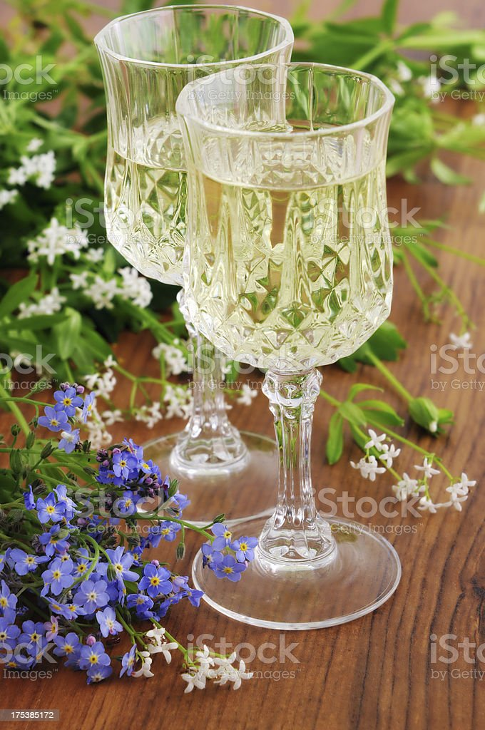 two liqueur glass of sweet woodruff punch (Galium odoratum) royalty-free stock photo
