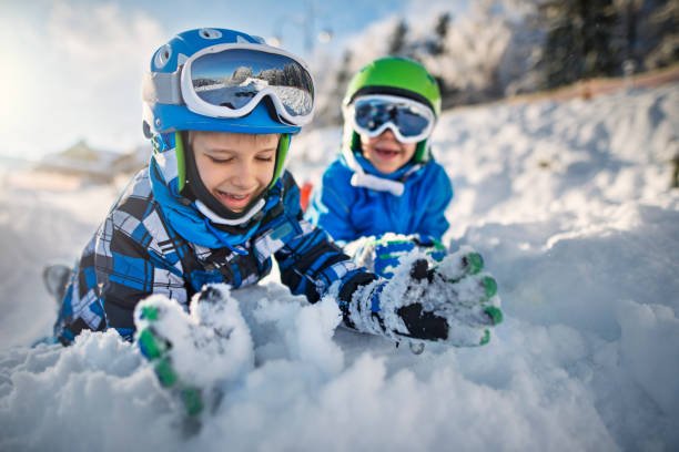 Two little boys in ski outfits playing in snow picture id654694452?b=1&k=6&m=654694452&s=612x612&w=0&h=vg6g 198ax4nlomff0ywn3bix2tsupvpwpy yrg0udi=