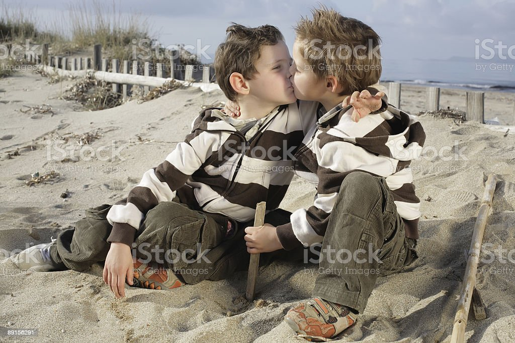 Two little boys kissing stock photo more pictures of beach istock two little boys kissing royalty free stock photo thecheapjerseys Gallery