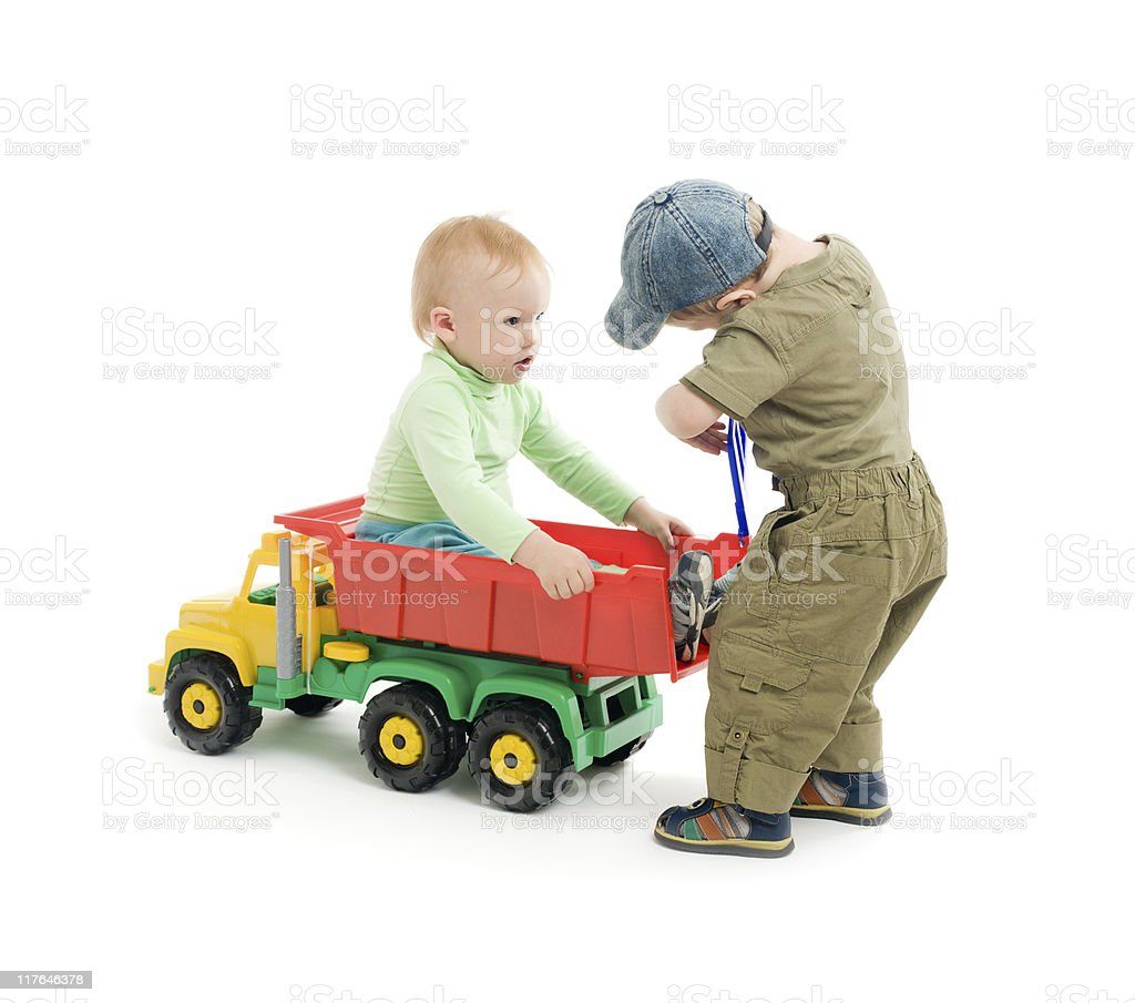 Two little boys play with toy truck royalty-free stock photo