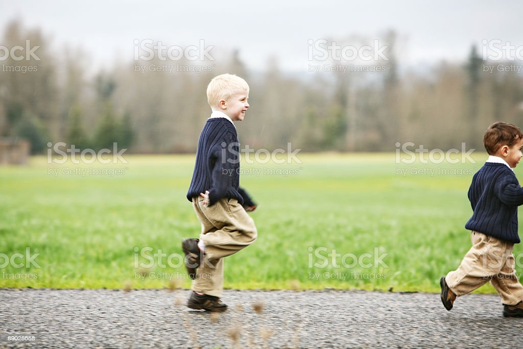 Two Little Boys Running and Stomping royalty-free stock photo
