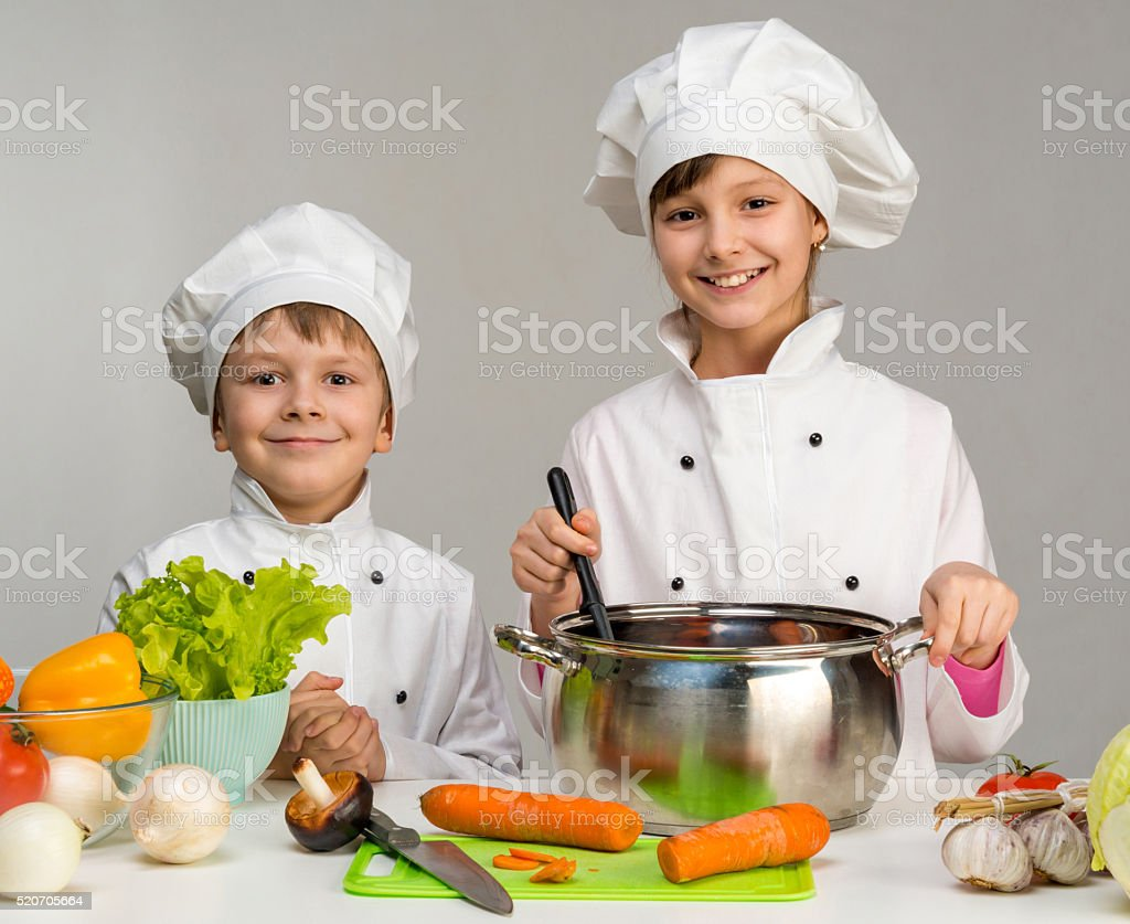 two little chefs cook and smile stock photo