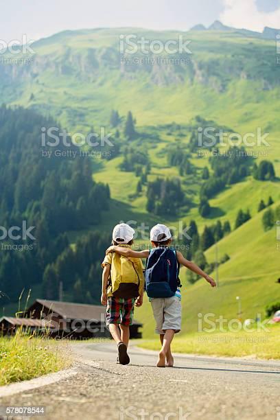 Two little children boy brothers with backpacks picture id578078544?b=1&k=6&m=578078544&s=612x612&h=3ncwhlgcrocydz9utmxjtbllznjk4rhj x ipxs xys=