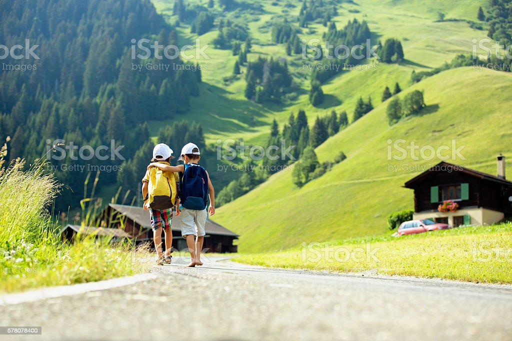 Two little children, boy brothers with backpacks travel stock photo