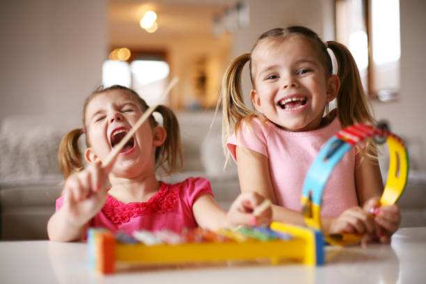 Two little girl at music school. stock photo