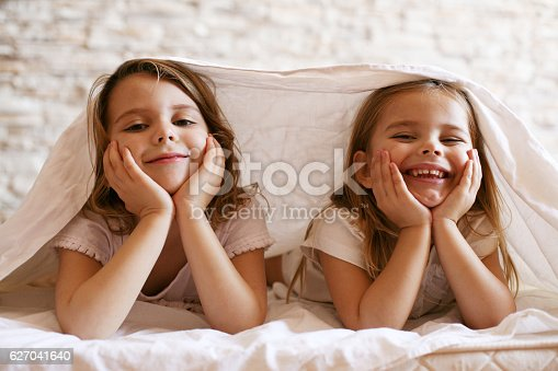 istock Two little girl in bed. 627041640