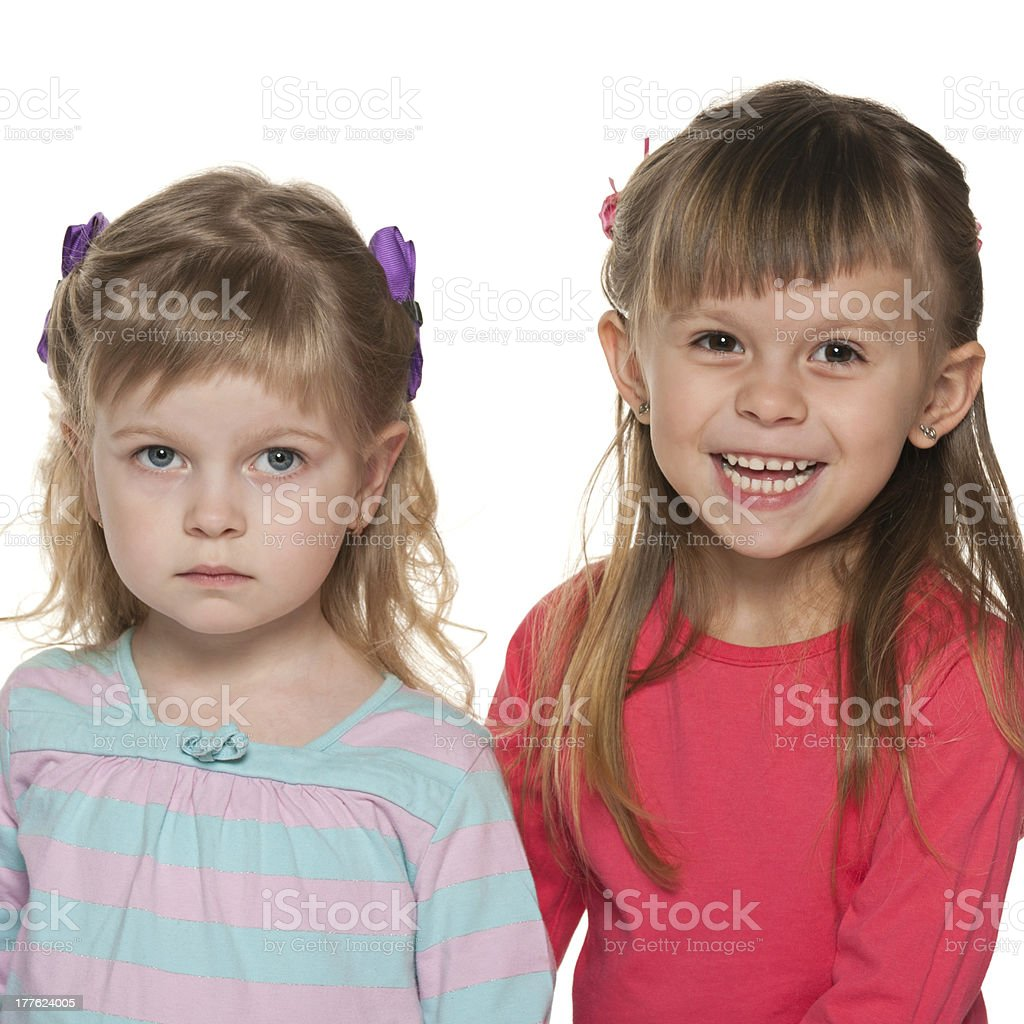 Two little girls are standing together royalty-free stock photo