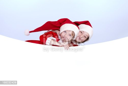 1069359694 istock photo Two little girls holding a banner 155232426