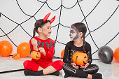 istock Two little girls in costumes decorations for Halloween 1167791087