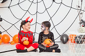 istock Two little girls in costumes decorations for Halloween 1167791090