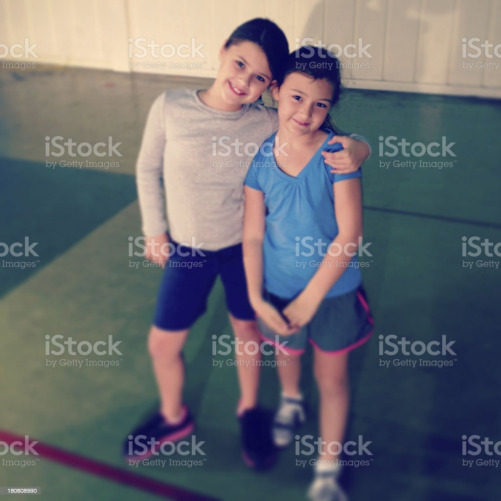 Two little girls in PE class stock photo