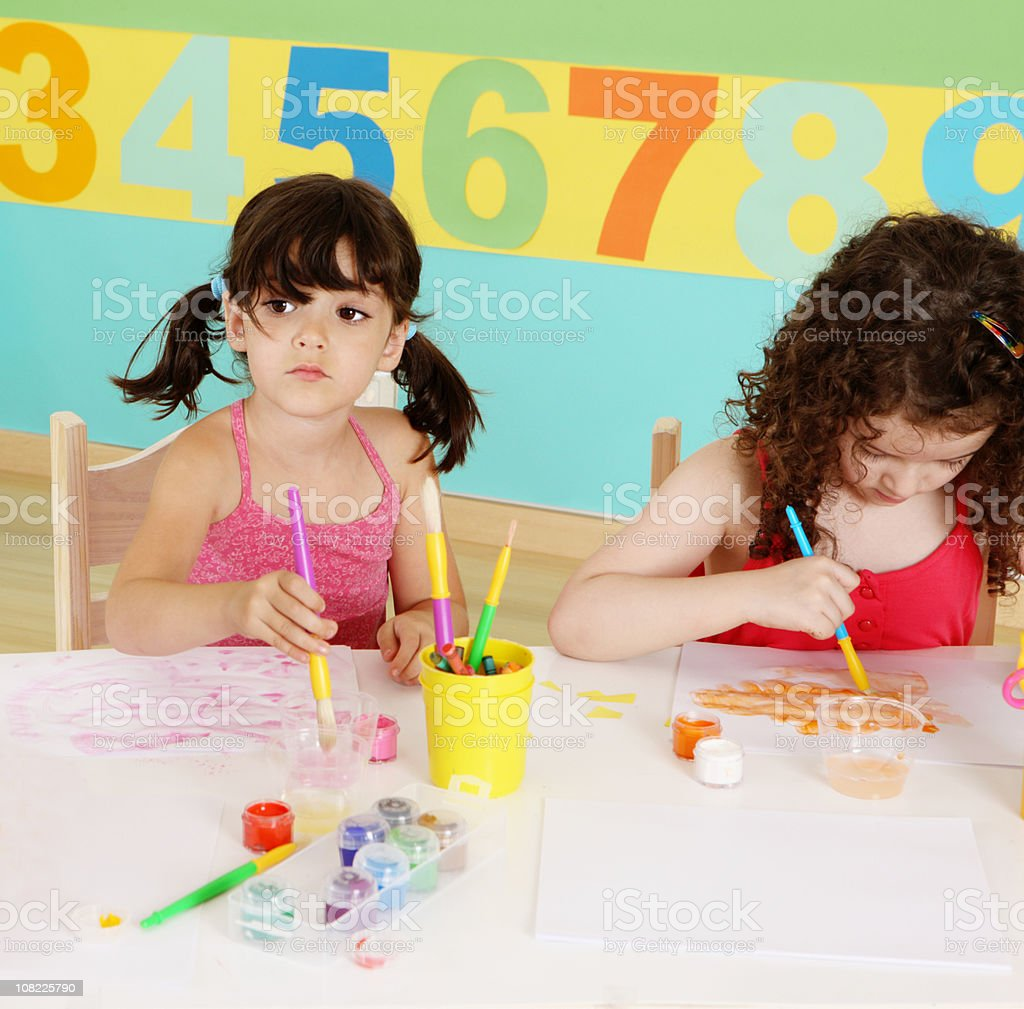 Two Little Girls Painting royalty-free stock photo