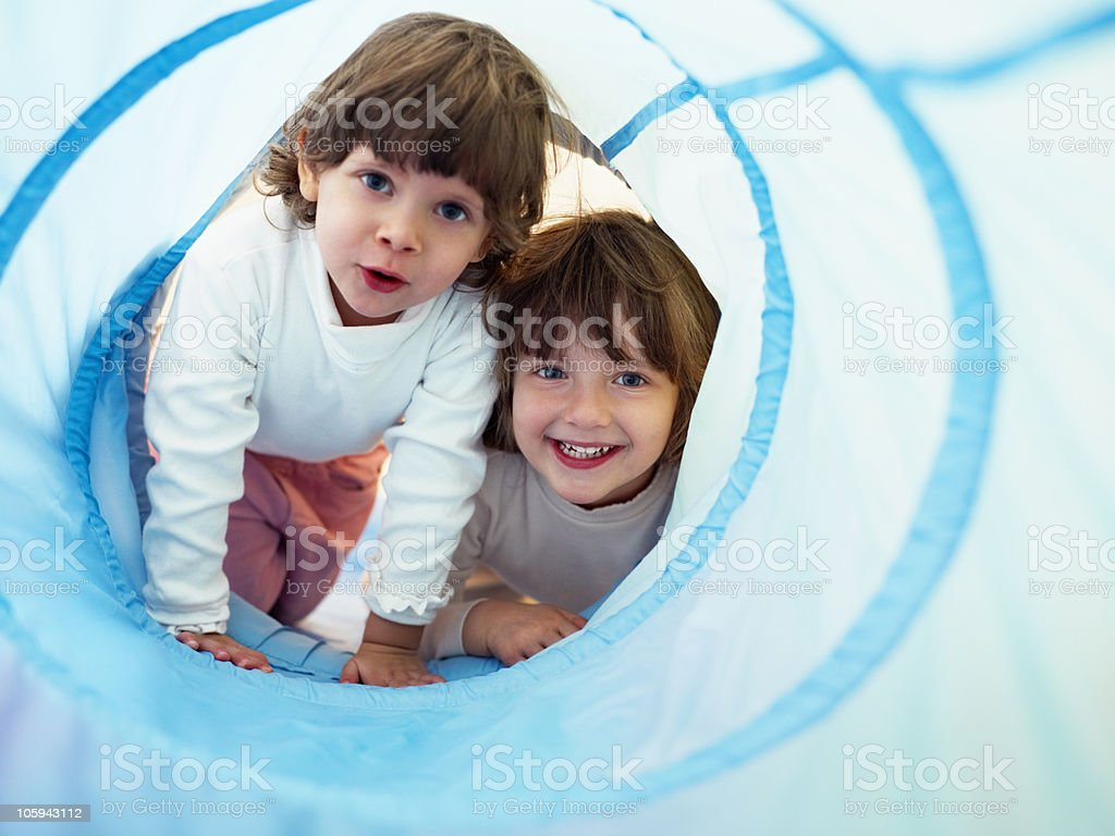 two little girls playing in kindergarten stock photo