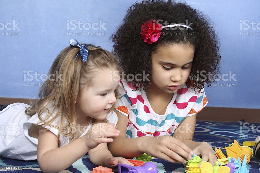 Two Little Girls Playing stock photo