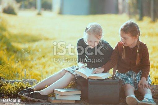 istock Two little girls ready back to school. 858701518