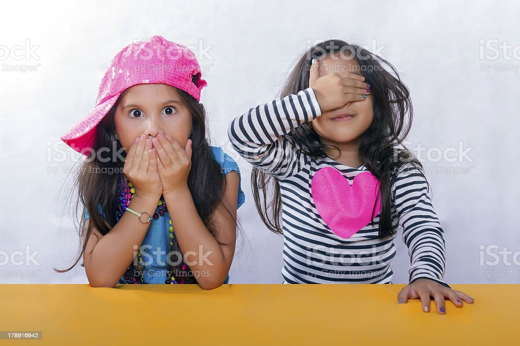 Two little girls seem surprised royalty-free stock photo