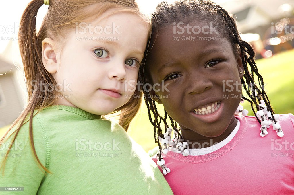 Two Little Girls Together Outside royalty-free stock photo