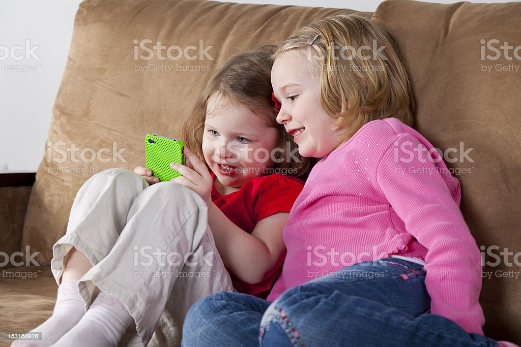 Two Little Girls with Cell Phone royalty-free stock photo