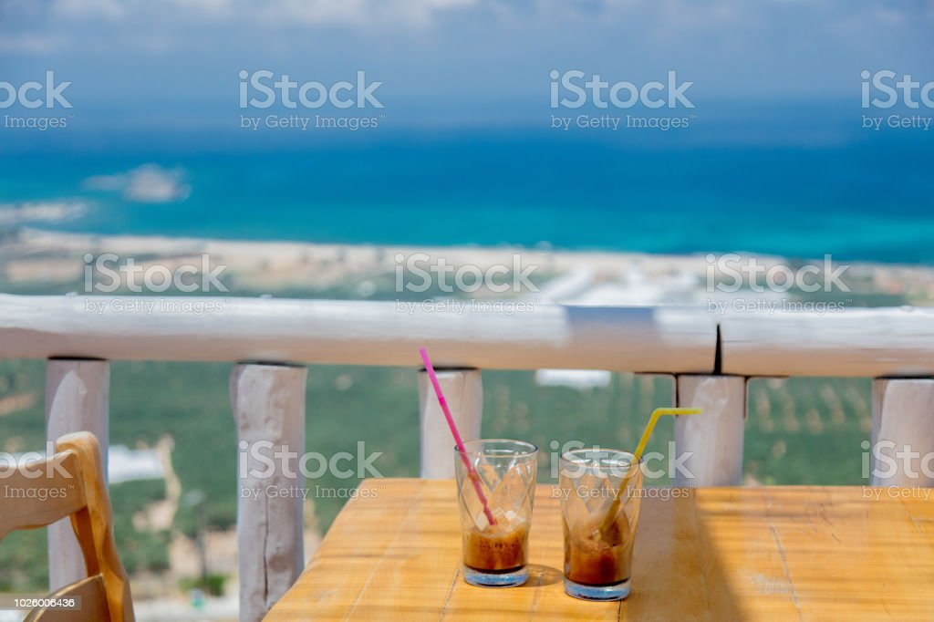 Two little glasses with cold cappuccino on a table stock photo
