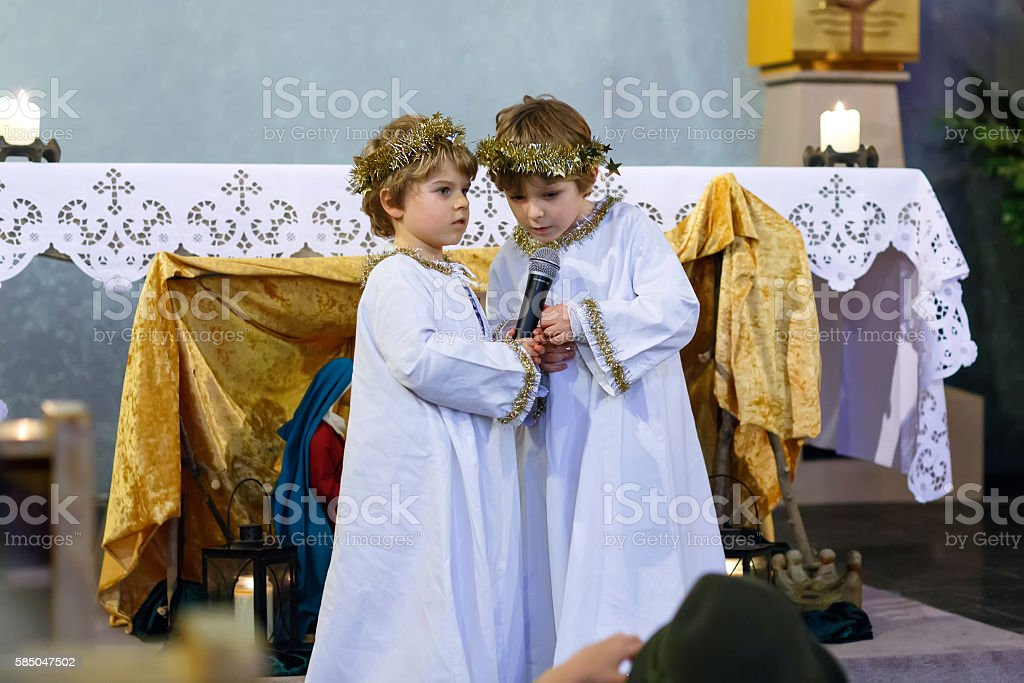 Two little kid boys playing at Christmas story in church stock photo
