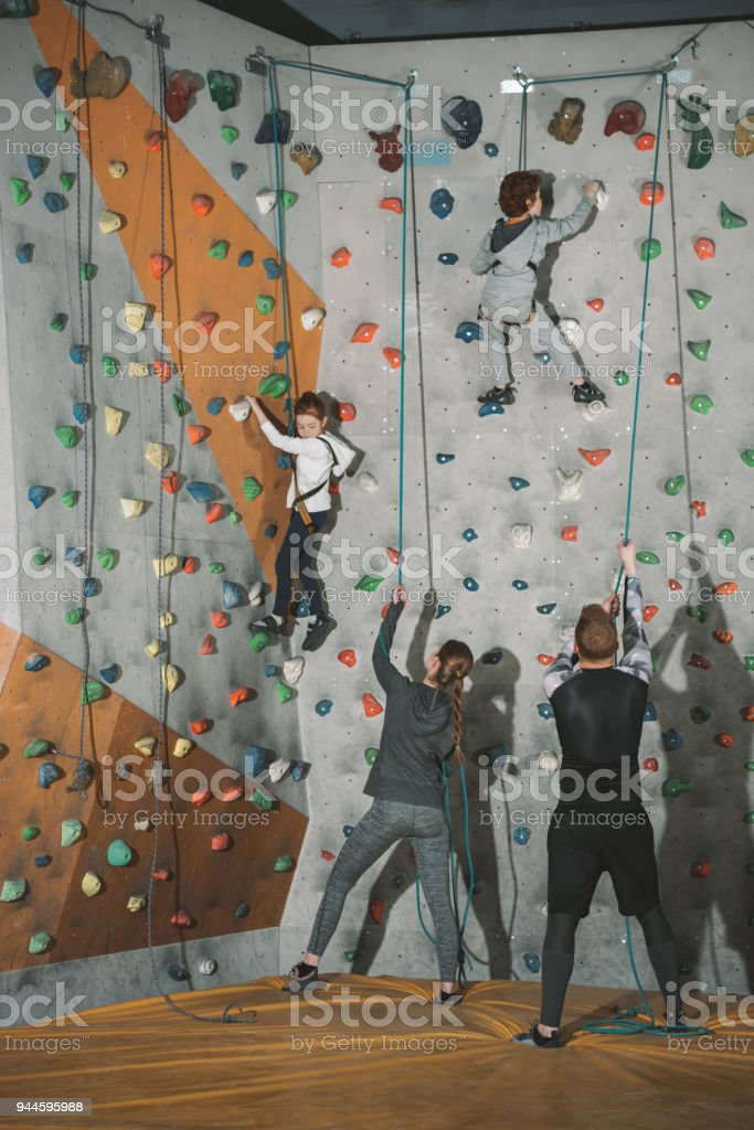 Two Little Kids Climbing Wall Stock Photo Download Image Now Istock