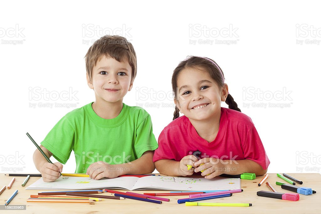 Two little kids draw with crayons stock photo