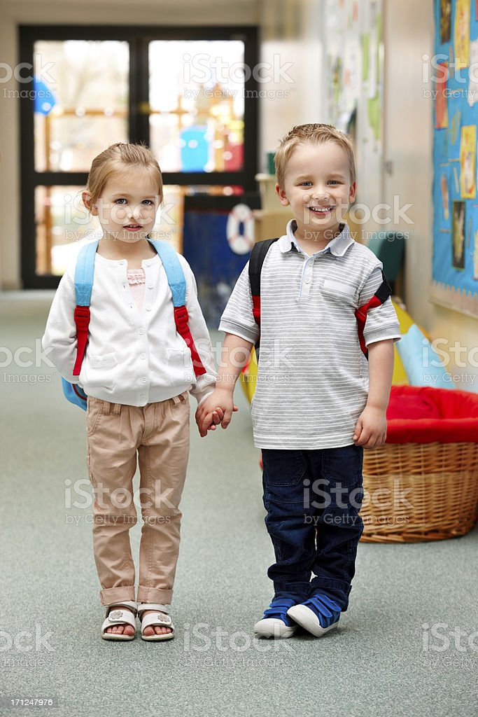 Two little kids in kindergarten stock photo