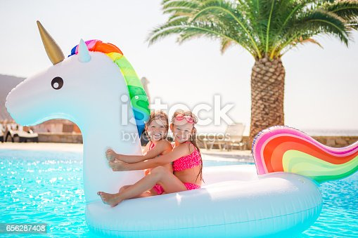 istock Two little kids playing in the swimming pool 656287408