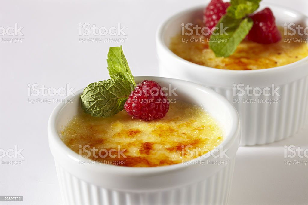 Two little pots of creme brulee stock photo