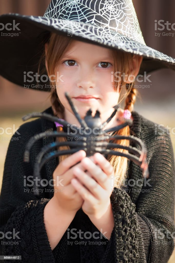 Two little sisters dressed like witches, trick or treat. stock photo