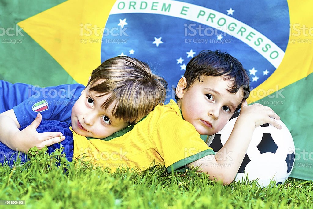 Two little soccer fans - Italy vs Brazil stock photo