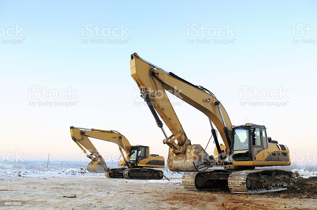 two loader excavators in winter royalty-free stock photo