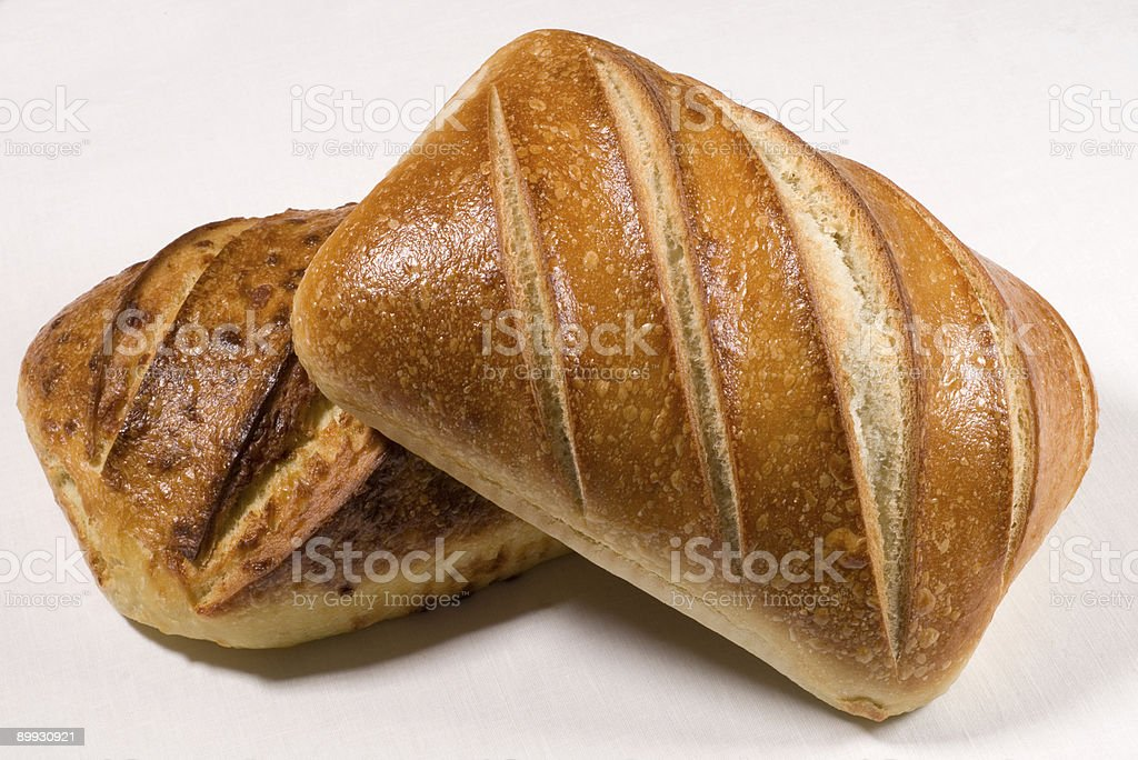 two loaves of crusty white bread. royalty-free stock photo