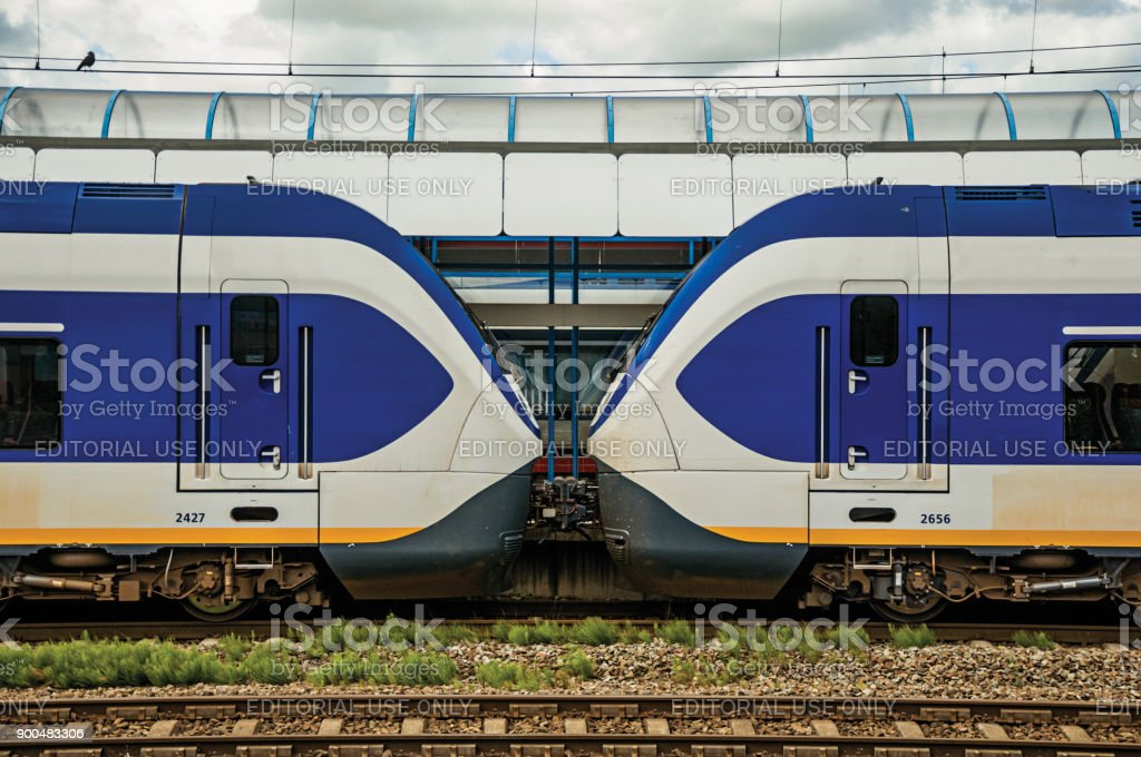 Two locomotives standing face to face that seem to kiss on the Weesp train station. stock photo