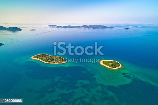 istock Two lonely stone islands in Zadar archipelago aerial view, Dalmatia region of Croatia 1089099886