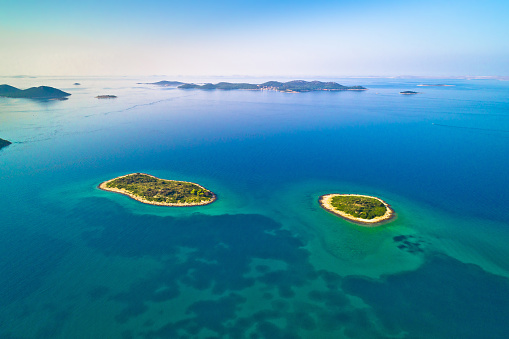 istock Two lonely stone islands in Zadar archipelago aerial view, Dalmatia region of Croatia 1089099886