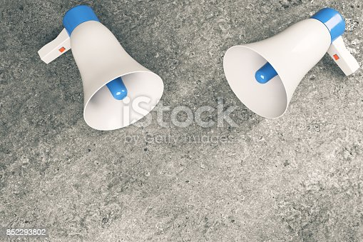 istock Two loud speakers on concrete background 852293802