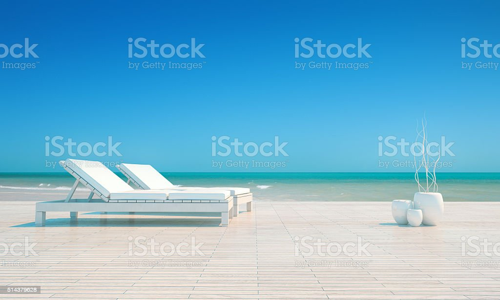 Two lounge chairs, luxury tourist resort, tropical beach, bright light stock photo