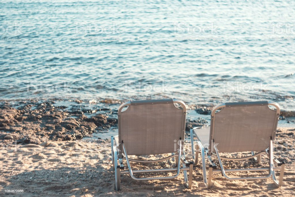 Enjoyable Two Lounge Chairs On Sand Beach By Sea At Sunset Stock Photo Inzonedesignstudio Interior Chair Design Inzonedesignstudiocom
