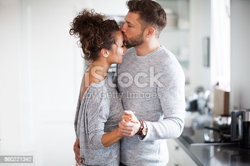 istock Two Lovers dancing in the kitchen. 860221342