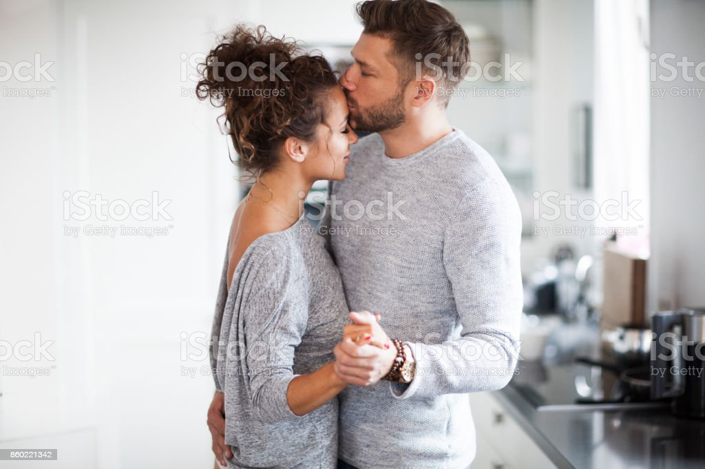 Two Lovers dancing in the kitchen. stock photo