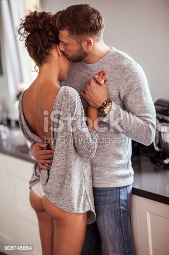 istock Two lovers dancing in the kitchen 908748684