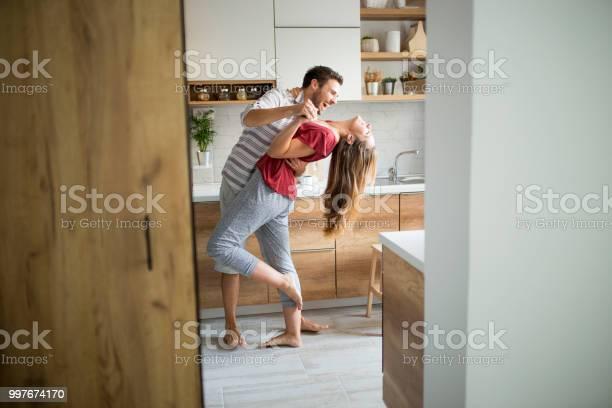 Two lovers dancing in the kitchen picture id997674170?b=1&k=6&m=997674170&s=612x612&h=p dhphpsytvlfiye2pcd2wmzset1likfjjnmnuuo4aq=