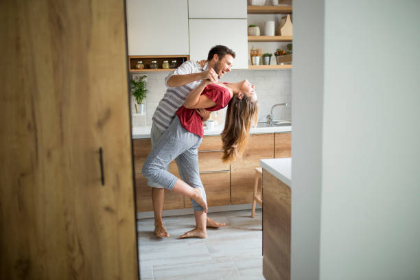 Two Lovers dancing in the kitchen. Two Lovers dancing in the kitchen. dancing stock pictures, royalty-free photos & images