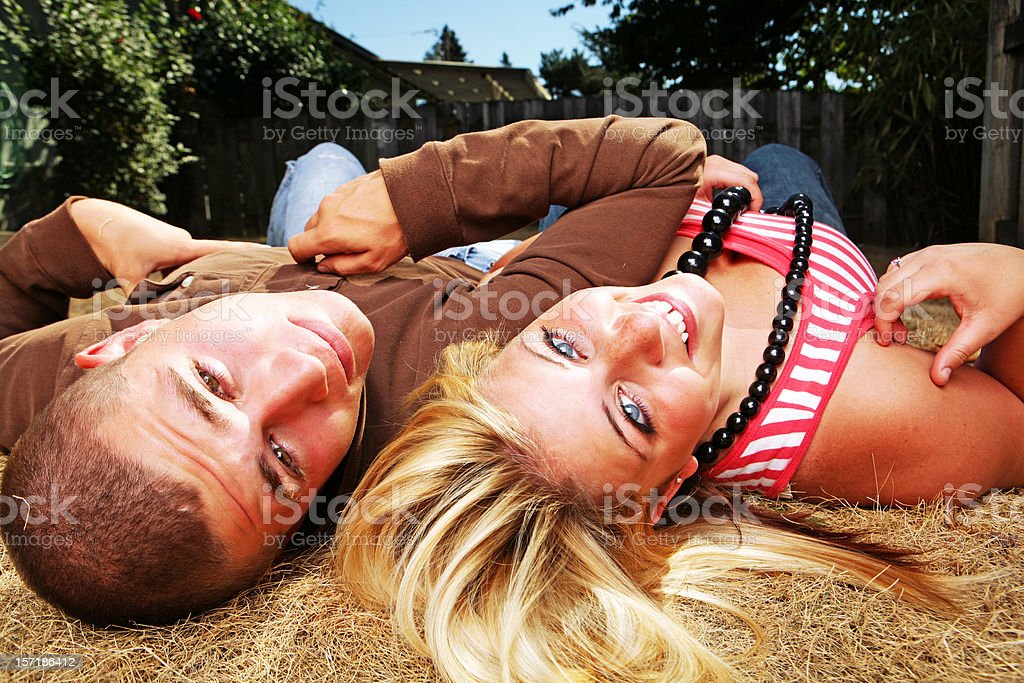 Two Lovers Laying Symmetrically. royalty-free stock photo