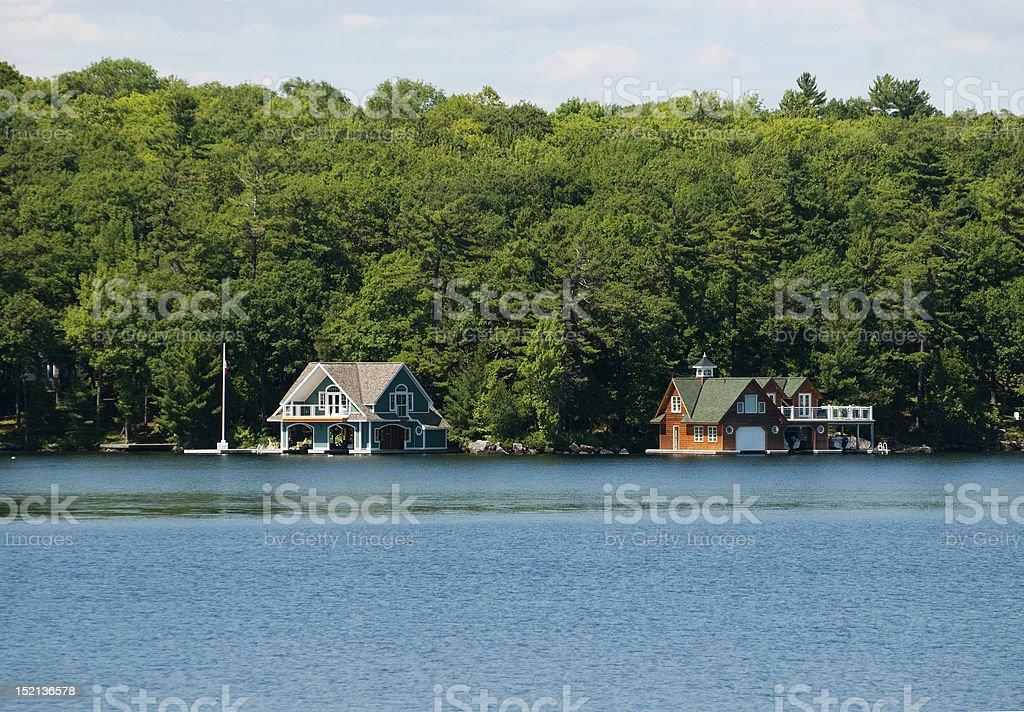 Two luxury boathouses stock photo