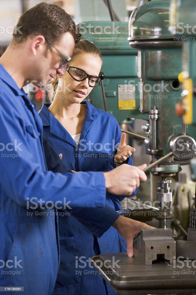 Two machinists working on machine stock photo