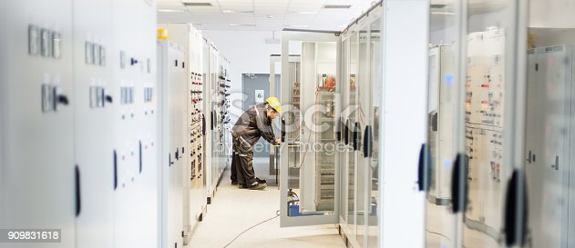 istock Two maintenance engineer work on relay protection system 909831618